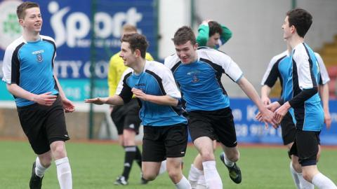 Michael Johnson wheels away in delight after putting Our Lady and St Patrick's 3-0 ahead against St Malachy's