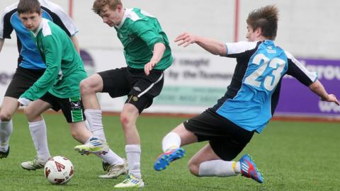 Peter Healy of St Malachy's is tackled by Our Lady and St Patrick's player Dominic Mooney in the Belfast Schools Senior Cup final at Solitude