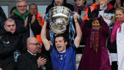 St Patrick's captain Conor Carville lifts the MacRory Cup after the 2-5 to 0-10 victory over St Paul's