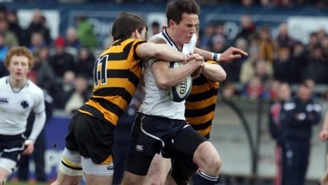 Two RBAI players halt the run of Methodist College centre Patrick Colhoun in the Schools' Cup final at Ravenhill