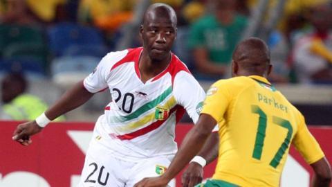 Samba Diakite (left)