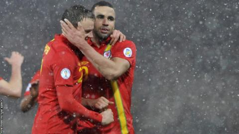 Robson Kanu celebrates his winner with Chris Gunther in Wales' 2-1 win over Scotland