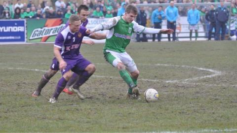 Guernsey FC's Matt Loaring under pressure from Spennymoor Town's Kallum Griffiths and Lewis Dodds