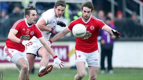 Kildare's Hugh Lynch with Mark Donnelly and Ronan McNamee of Tyrone