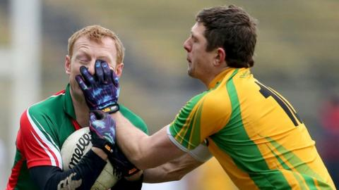 Mayo's Richie Feeney and Ryan Bradley of Donegal