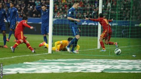 Pedro celebrates scoring for Spain against France