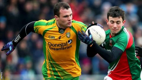 Neil McGee battles with Mayo's Jason Doherty in Sunday's Football League clash
