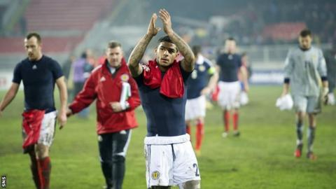 Liam Bridcutt and Scotland players at full time following the defeat by Serbia