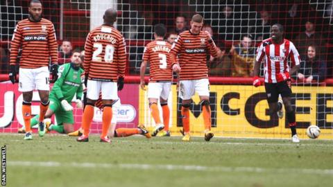 Notts County's players look crestfallen after conceding he opening goal against Brentford at Griffin Park