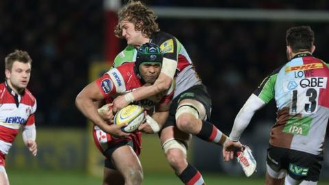 Gloucester's Akapusi Qera is tackled by Quins' Luke Wallace at Kingsholm