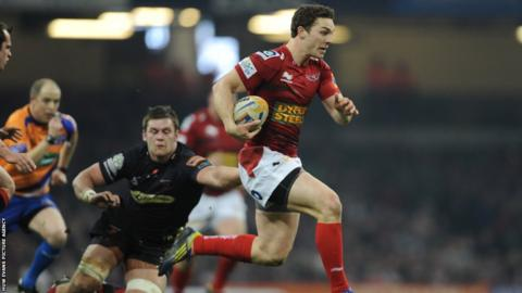 Scarlets wing George North races away for the opening try against the Dragons as 'Judgement Day' gets underway at the Millennium Stadium