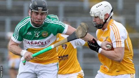 Offaly's Shane Dooley tries to fend off Antrim's Aaron Graffin