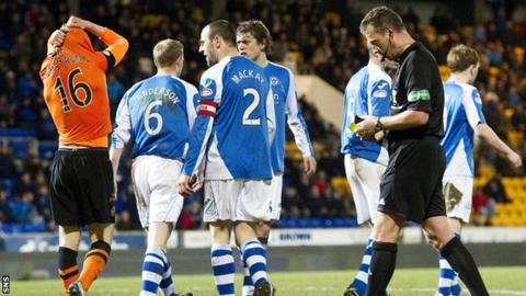 Dundee United midfielder Stuart Armstrong is send off by referee Iain Brines