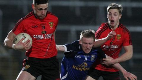 Down's Conor Gough and Jerome Johnston in action against Chris Conroy of Cavan