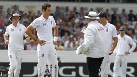 Steve Finn and umpire Steve Davis