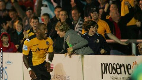 Aaron O'Connor celebrates in front of Newport supporters