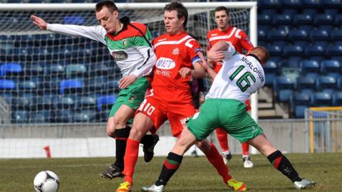 Glentoran pair Jason Hill and Stephen McAlorum ensure there is no way through for Portadown striker Kevin Braniff at a sun-kissed Windsor Park