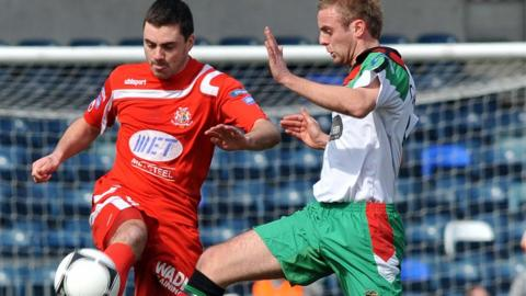 Portadown's Chris Ramsey battles for possession with Richard Clarke