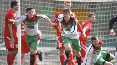 Glens substitute Markus Kane runs away in delight after scoring the goal which gave the east Belfast side a 1-0 victory over Portadown
