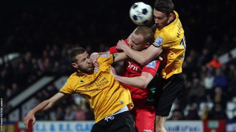 Newport County's Lee Minshull is closely marked
