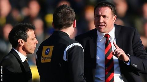 Cardiff City manager Malky Mackay reacts to fourth official Lee Collins as Watford boss Gianfranco Zola shuts his eyes to the issue