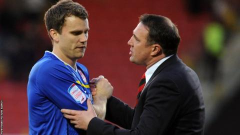 Cardiff boss Malky Mackay congratulates Ben Turner