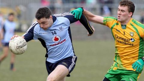 Dublin's Paddy Andrews in posession against Donegal's Eamonn McGee