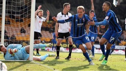 Paul Benson celebrates scoring for Cheltenham against Port Vale