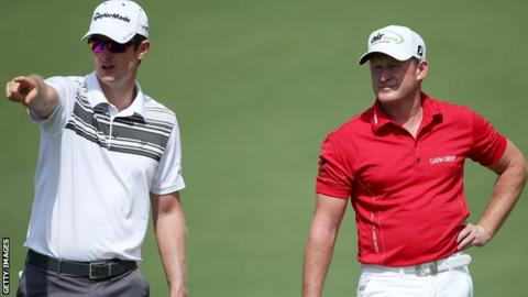 Jamie Donaldson (right) receives some guidance at Augusta from Justin Rose