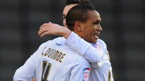 Mathias Doumbe celebrates scoring for MK Dons