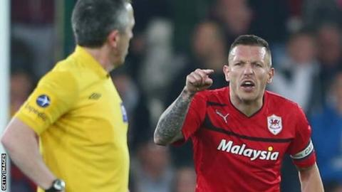 Cardiff's Craig Bellamy remonstrates with the referee after Barnsley's late equaliser