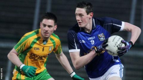 Cavan's Michael Argue tries to burst away from Donegal's Martin O'Reilly
