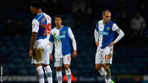 Blackburn Rovers players look dejected after conceding a goal