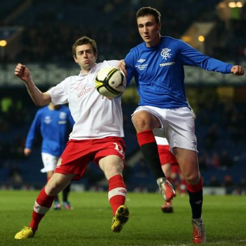 Gary Browne of Linfield competes with Kal Naismith of Rangers during the friendly match at Ibrox