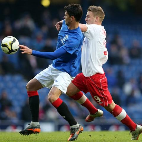 Emilson Cribari of Rangers competes with Linfield striker Peter Thompson