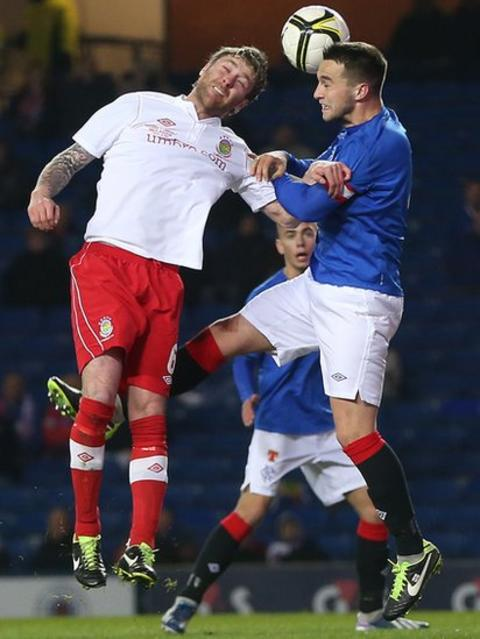 Ryan Henderson of Linfield goes up for a high ball with Chris Hegarty of Rangers