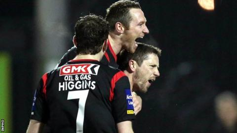 Rory Patterson (right) celebrates after scoring his second penalty
