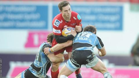 Wing George North, who will leave the Scarlets for Northampton in the summer, is tackled by Glasgow's Ruaridh Jackson and Peter Horne.