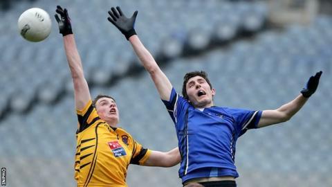 Maghera's Peter Cassidy battles with Navan's Donal Ryan