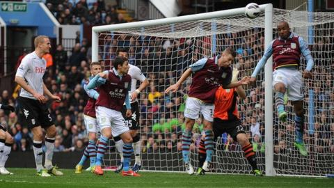 Aston Villa midfielder Fabian Delph heads into his own net against Fulham