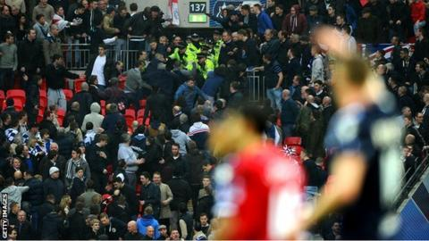 Millwall supporters clash with police