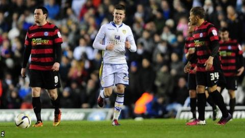 Sam Byram (centre) in action for Leeds United