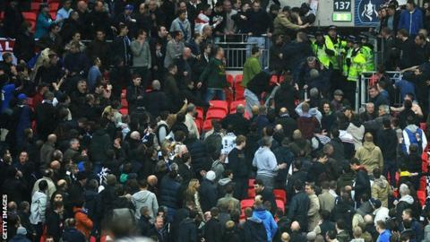 Violence erupts in the Millwall end in the FA Cup semi-final against Wigan at Wembley
