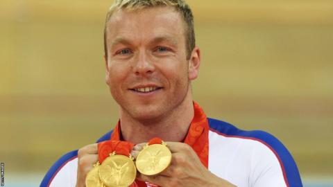 Chris Hoy poses with the gold medals won during the 2008 Beijing Olympic