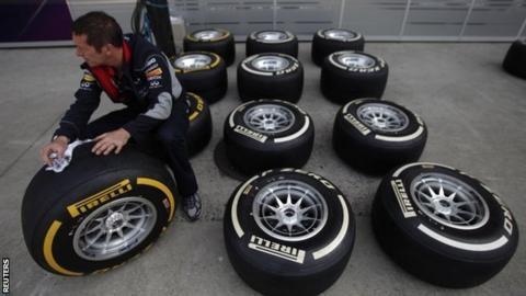 Red Bull mechanic with tyres