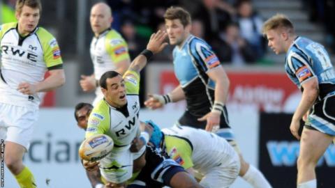 Ospreys scrum-half Khan Fotuali'i is tackled by Nikola Mtawalu of Glasgow