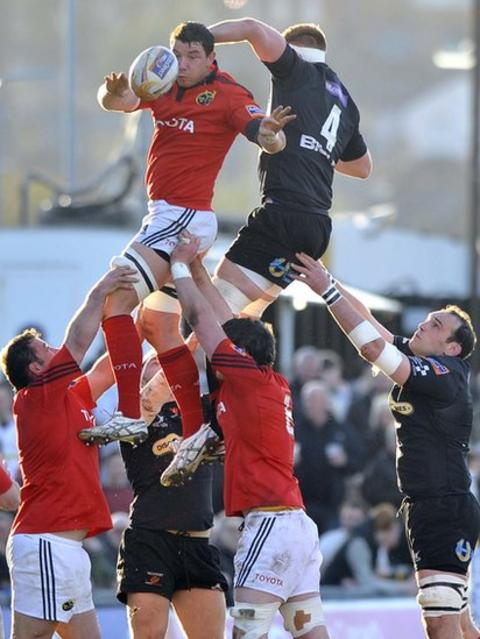 Munster's David Foley beats Dragons' Andrew Coombs in the air for the ball