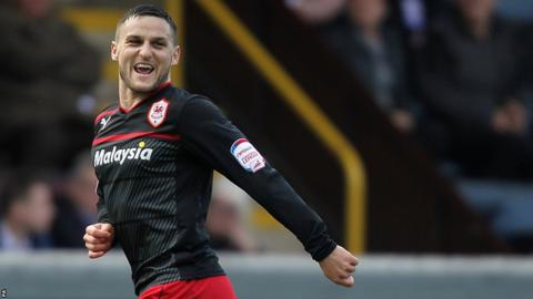 Craig Conway wheels away in delight after the Scotsman gave Cardiff a first-half lead at Turf Moor.