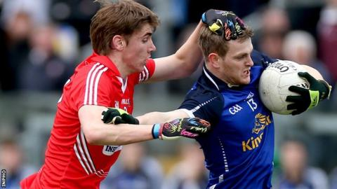 Cork's Ian Maguire challenges Enda Reilly in the semi-final
