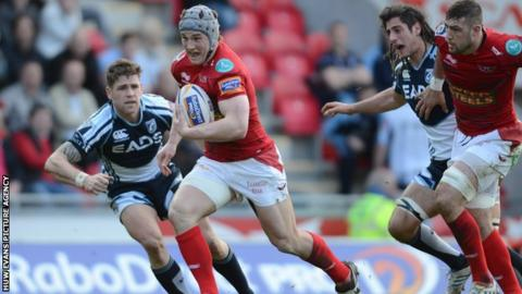 Jon Davies races away to score a try for Scarlets